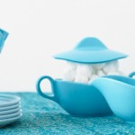 turquoise cup set on table